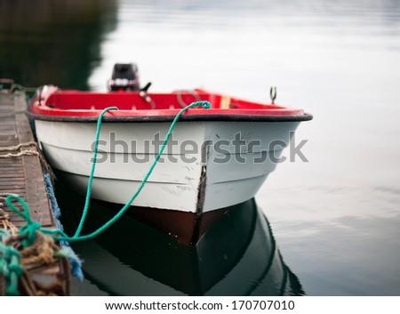 Open boat by a dock