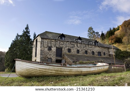 open boat in front of old warehouse on an autumn day