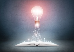 Open book and glowing light bulb over it. Knowledge, education concept