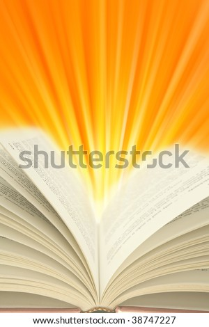 Open book and light rays. Copy space