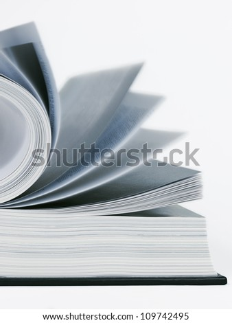 Open book and pages in motion