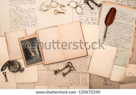 open book, antique accessories, old letters and postcards. nostalgic vintage new year's background