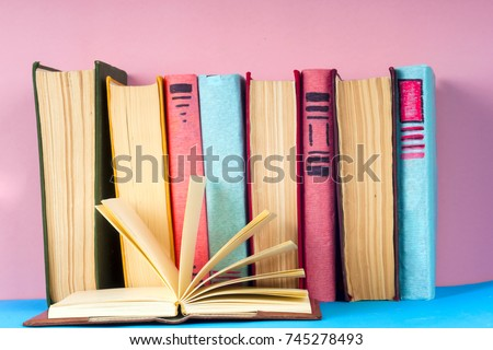 Open book, hardback books on bright colorful background. Back to school. Copy space for text #745278493