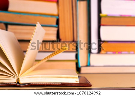 Open book, hardback books on bright colorful background. Back to school. Copy space for text. Set of books in the library. Knowledge, Science.