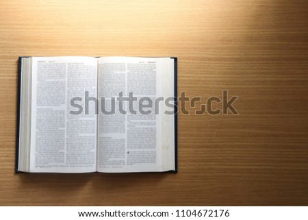 Open book Holy Bible on a wooden background. Christianity concept. Holy Bible background. Holy Bible wallpaper. Faith hope love concept. #1104672176