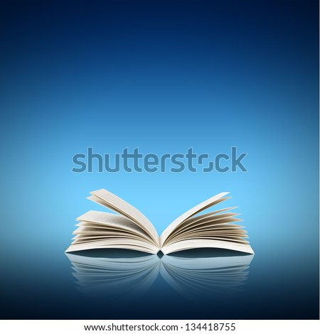 Open book isolated on blue background