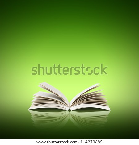Open book isolated on green background