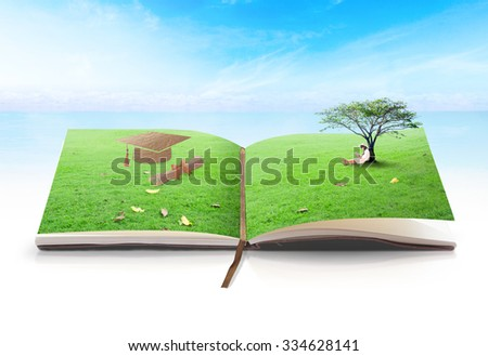 Open book of nature in a asian girl reading book under big tree with graduation cap made of brown fabric texture on meadow over blue sky background. Reading leads to the success concept.