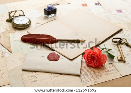 open book, old accessories and post cards. romantic vintage background