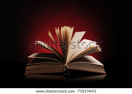 Open book on a dark red background