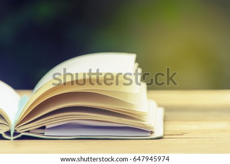 open book on a wooden table....