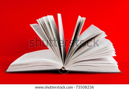 Open book on red background