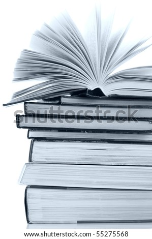Open book on stack of books against white background. Toned monochrome image.