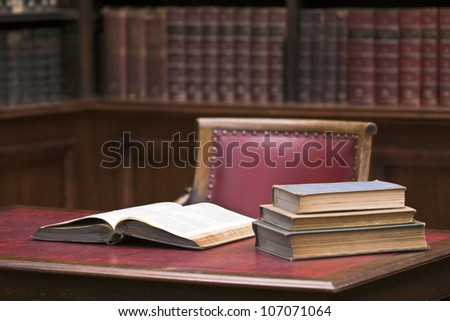 Open book on the table. Educational environment. Selective focus on opened book
