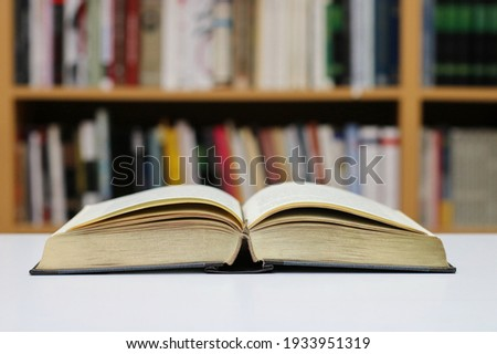 Open book on the table in library Сток-фото ©