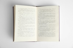 Open book on white background, top view. Space for text