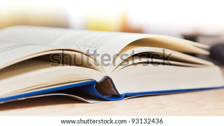 Open book on wood