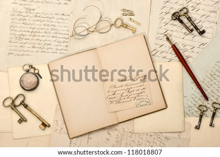 open book, vintage accessories, old letters and postcards. nostalgic background