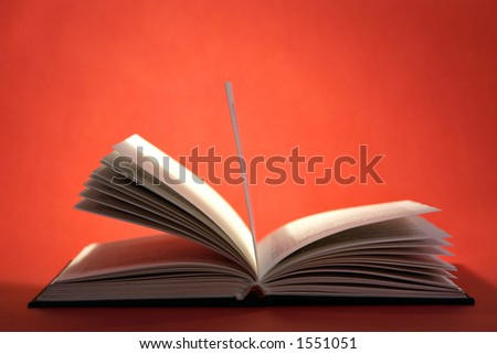 Open book with pages on red background