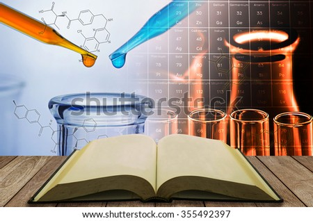 open book with science laboratory test tube background