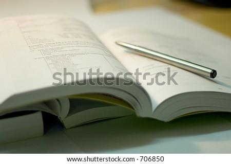 open book with steel pen, soft focus