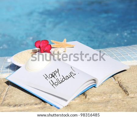 open book with strfish outdoor with swiming pool background