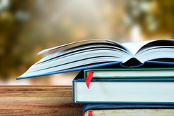 Open books and blur nature background.
