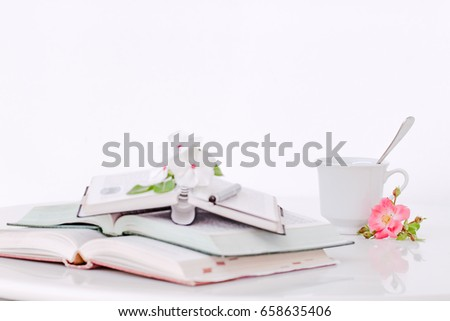 open books with flowers and...
