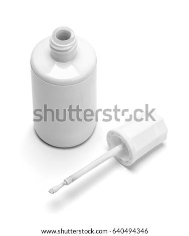 Open Bottle of Correction Paint Isolated on White Background.