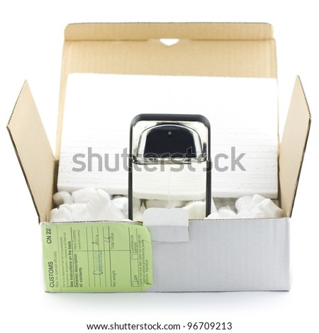 Open box with packing 'peanuts' and perfume isolated on white