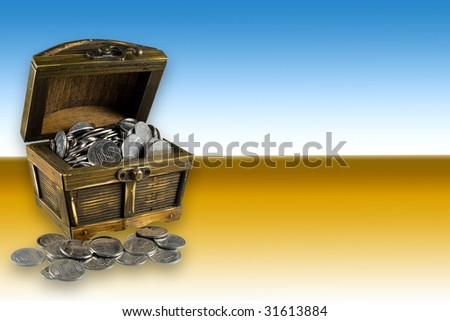 Open brown chest with many silver coins