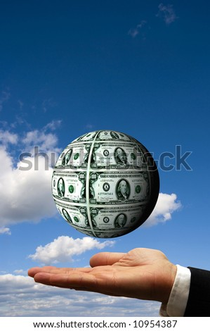 open businessman hand with a dollar sphere floating over it
