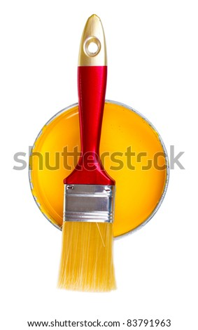 open can of yellow paint and brush isolated on white