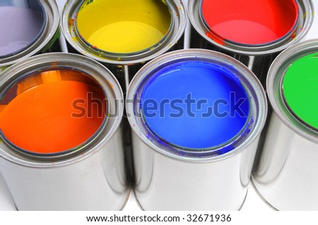 Open cans of paint in close up view