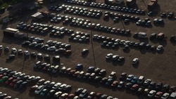 Open car parking top view. Parking with cars from a bird's eye view