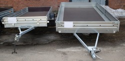 Open car trailer. Trailer for passenger cars.Sale, rental and maintenance of trailers.
