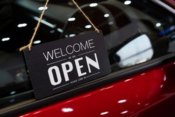 open car  with red car in dealership for door car  ideas unlock freedom tourist travel for lifestyle customer from salesman sign welcomenew normol during Coronavirus disease covid-19 unlock lockdown
