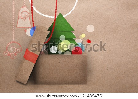 Open cardboard box with colorful lights and Christmas tree getting out and decorations in the background