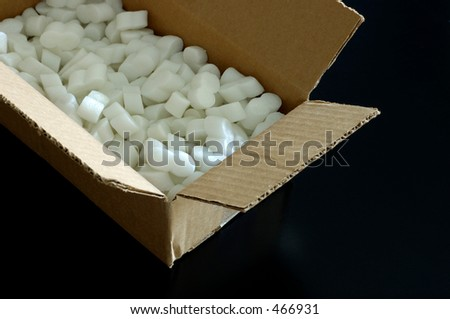 Open cardboard box with packing styrofoam peanuts inside