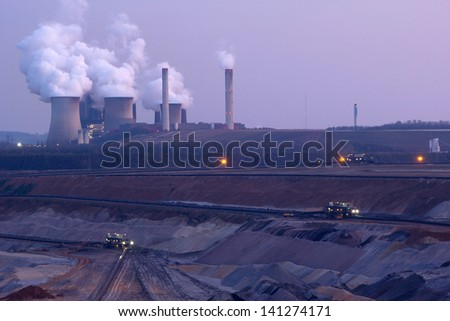 Open cast mine lignite and cooling towers of a large power station