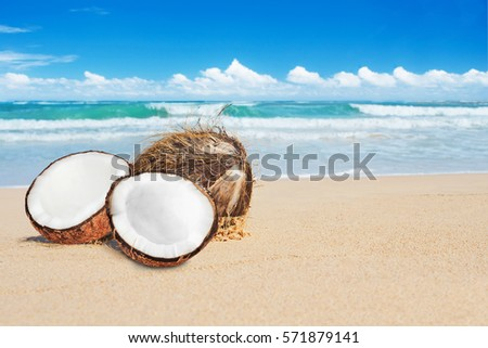 open coconut on tropical beach  ...