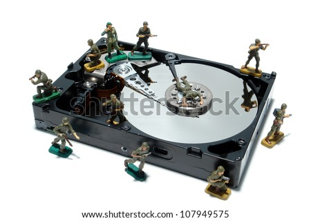Open computer hard disc drive hardware component with miniature toy figurines army soldiers white as concept illustration for virus and malware protection (1 in a series of 6)