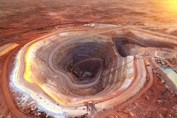 Open cut gold mining operation in remote Australia showing pit and spoil piles