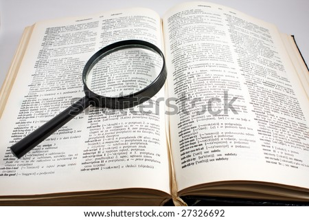 Open dictionary book and magnifier stock photo 27326692 for Open dictionary