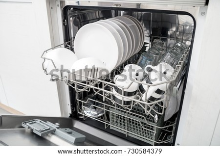 dishwasher clipart black and white. open dishwasher with clean dishes in the white kitchen clipart black and