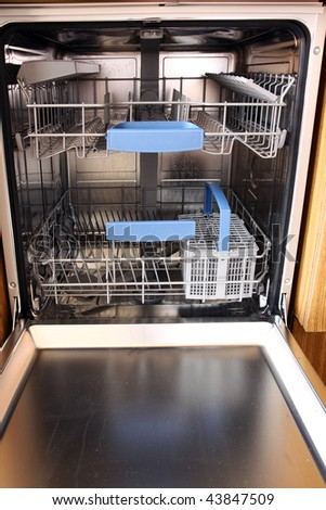 open dishwasher without dishes in kitchen