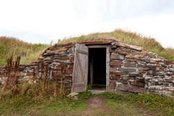Open door historic vintage root cellar dug underground near Elliston, Newfoundland, NL, Canada