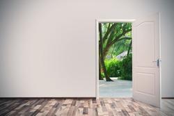 Open door leading to tropical garden