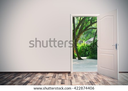 Open door leading to tropical garden
