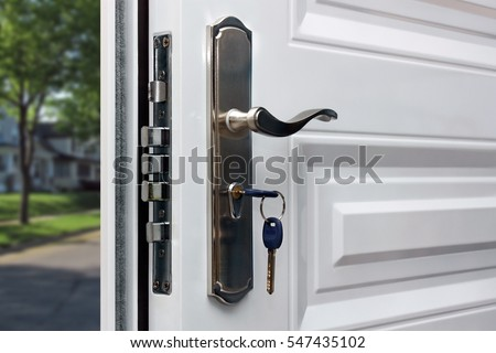 Open door of a family home. Close-up of the lock with your keys on an armored door. Security. - Shutterstock ID 547435102